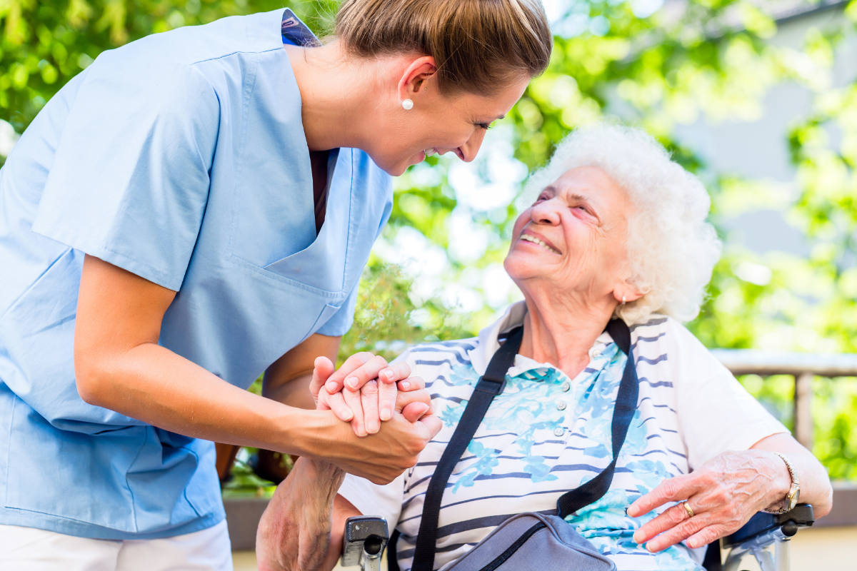 female Alzheimer's client with female caregiver
